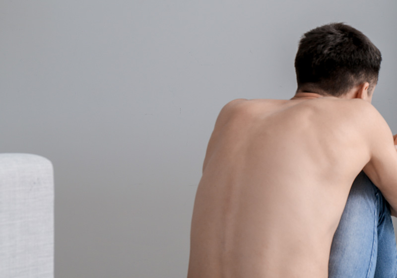 Young man with eating disorder
